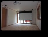 越谷市Y様邸自然素材リビングに100インチのホームシアター